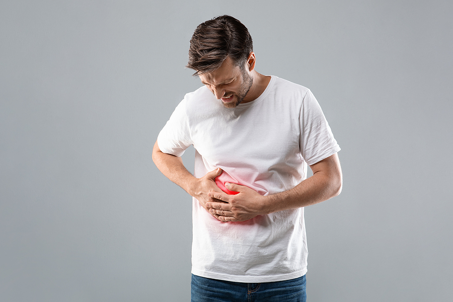 Middle-aged suffering from liver pain